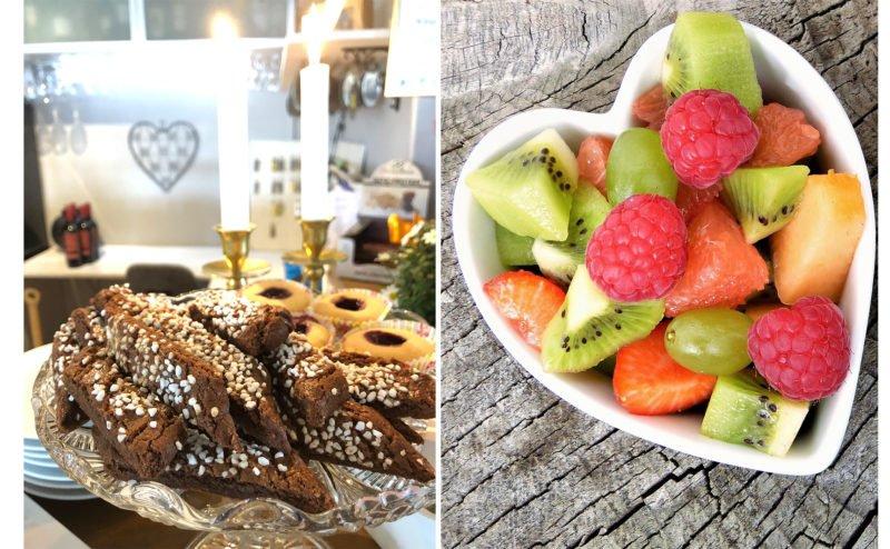 Kakfat med chokladrutor och hallongrottor och hjärtformad porslinsskål med frukt